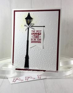 "Brightly Lit Christmas Lamppost with banner cardLove my simple Brightly Lit Christmas Lamppost with banner card. Other than some easy sponging this Christmas card is very quick. Notice the small ""flame"" inside the light? It's the little things!Start with an A2 card base..."