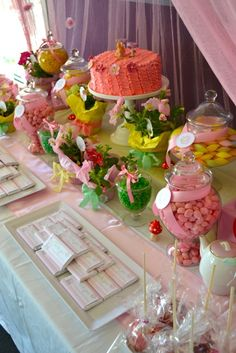 Tea party dessert table with a ruffle cake