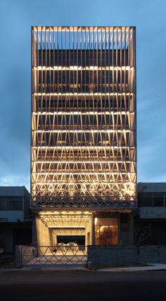 office facade. simple factory building pencil office in singapore lit street facade photos l