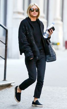 Ashley Olsen is sleek in an all-black ensemble and comfortable slip-on sneakers in SoHo. http://www.eonline.com/photos/6415/celebrity-street-style/242590