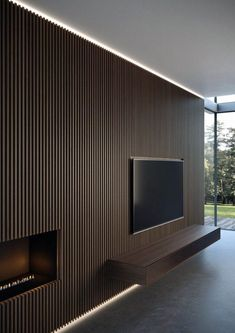 New wall paneling from Moderne Living reinvents the very concept of wall cladding, in a more amplified and contemporary way. 1 Bedroom Apartment, Apartment Interior, Living Room Interior, Tv Wanddekor, Wood Slat Wall, Living Room Tv Unit Designs, Tv Wall Decor, Tv Wall Design, Interior Design
