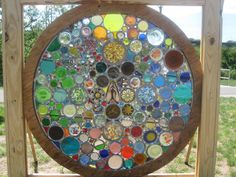 """They are made from scraps of historical stained glass and the bottoms of  recycled glass bottles that I find all over the city. The first one I made for  an event here in Philadelphia called Art In The Open. It took me three days to  build it on site along the Schuykill River. It spins in the square frame and is  viewed through a giant kaleidoscope""."