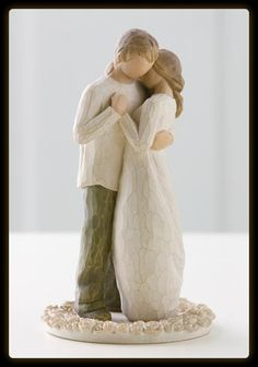 Willow Tree cake topper; I would actually love this, because then it can be displayed in the home after the big day!