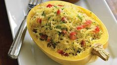 spagetti squash recipie with cheese, cottage cheese, plum tomato   spaghetti squash, halved lengthwise and seeds removed