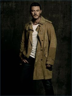 Actor Luke Evans wears a Ralph Lauren Purple Label coat with a Lot 78 t-shirt, and Citizens of Humanity jeans.