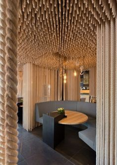 Found this design really interesting and such a good idea. love the use of ropes to add a statement to the space.