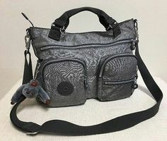 Kipling Adomma, Features removable and adjustable shoulder strap. zip front  pocket; zipped main
