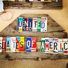 UNITED STATES of AMERICA upcycled recycle license plate art sign mounted on barn wood tomboyART OoaK Made in America Woody Guthrie. $460.00, via Etsy.