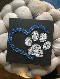 paw print string art paw print string art,Selber machen Related posts:The ultimate guide for the best keto Starbucks drinks that are low carb healthy . Nail String Art, String Crafts, Resin Crafts, String Art Templates, String Art Patterns, Dog Crafts, Diy Arts And Crafts, Wooden Wall Art, Wood Art