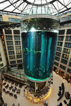 The AquaDom in Berlin, Germany, is a 25 metre tall cylindrical acrylic glass aquarium with built-in transparent elevator. It is located at the Radisson Blu Hotel in Berlin-Mitte.