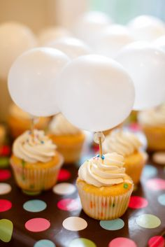 What a creative idea!  Balloon cupcake toppers at a birthday party!  See more party ideas at CatchMyParty.com!