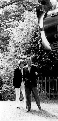 """David Hemmings and director Michelangelo Antonioni on the set of """"Blow-up""""."""