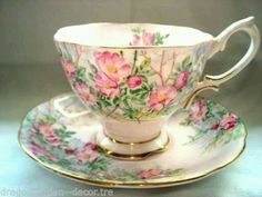 Royal Albert   'Wild Rose' Pattern   Teacup & Saucer   ca. 1940s   English   Bone China   In the Malvern shape, it has a blush pink background with pink wild roses and gold trim.