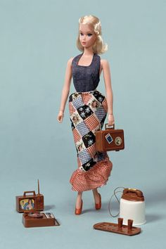 Loved her and her outfit!!  Google Image Result for http://www.barbieimages.com/images/barbie/1972-Busy-Barbie.jpg