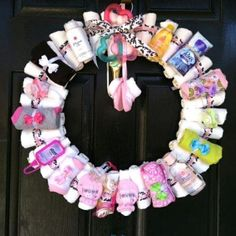 Diaper Wreath with mini baby products! this would be fun to make