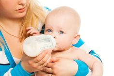 Mother feed cute little boy with bottle with formula milk Stock Photo , Best Twin Strollers, Cheap Baby Strollers, Double Baby Strollers, Baby Girl Strollers, Toddler Stroller, Baby Prams, Uppababy Stroller, Pram Stroller, Umbrella Stroller