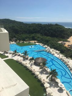 Secrets Huatulco Resort & Spa // Tucked away on the secluded coastline of Conejos Bay, surrounded by golden sand, extraordinary rock formations and sapphire waters, this fabulous AAA Four Diamond resort offers adults an escape to serenity, romance and Unlimited-Luxury®.