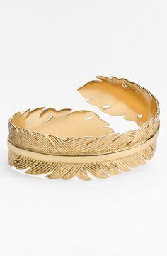 Such a pretty gold feather cuff.