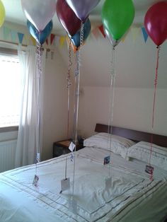 Birthday Surprise - Floating photos    I am so doing this for Chayse on Friday!!!!!!!!!