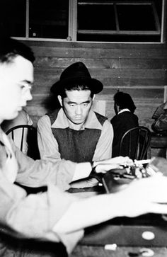 Processing a segregant, Sept. 1943, Tule Lake concentration camp, California.  National Archives and Records Administration.