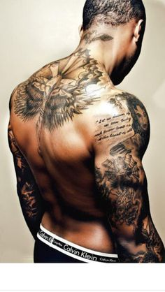 Muscular Black and Gray Tattoo