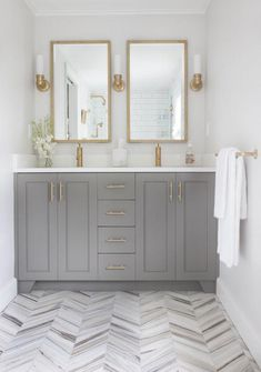 grey and gold bathroom gorgeous double mirrors and sinks herringbone floor Source by cmlooking The post Grey & Gold: The Perfect Balance of Warm with Cool appeared first on Isadora Design. Gold Bathroom, Bathroom Renos, Bathroom Flooring, Master Bathroom, Bathroom Ideas, Bathroom Storage, Bathroom Double Vanity, Bathroom Canisters, Bathroom Renovations