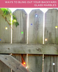 drill holes in fence, add marbles. Four Ways to Bling Out Your Backyard