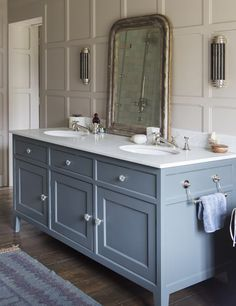 Beautiful bathroom in a transitional style country home.  The paneled walls are an unexpected treatment in a bathroom.  By Mark Taylor Design.