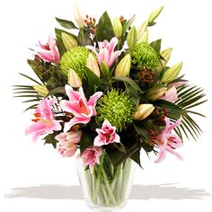 Serenity Hand-tied  Hand-tied by professional florists this stylish bouquet of the freshest pink oriental Lilies is carefully arranged in the hand with plump sprays of trendy Hypericum berries, Aspidistra leaves, Kentia Palm and lime green Shamrock Chrysanthemum Blooms. #wedding #flowers