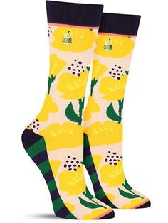 """This ain't your mama's floral print. These fun and pretty """"cup of gold"""" flower socks feature buttercup-like blooms in a big, bold print, with green stripes hidden on the soles of the feet and even a f"""