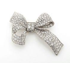 A diamond set bow brooch, circa The realistically formed brooch pavé set overall with graduated round brilliant cut diamonds in platinum. Bow Jewelry, High Jewelry, Diamond Jewelry, Jewellery Box, Diamond Pendant, Bijoux Art Deco, Art Deco Jewelry, Jewelry Crafts, Diamond Bows