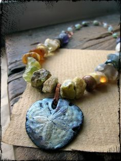 Raku pendant necklace Sand dollar ceramic Mixed by HerWhimsy