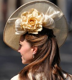 """Kate Middleton in a very distinctive hat that is described as """"Pringle chipesque.""""  Lovely...in its own way, I suppose."""