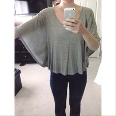 NWOT Grey Batwing Top BRAND: Rewind  SIZE: Extra Small (but a bit oversized)  CONDITION: New without tags. Only worn to model.  FEATURES: - Batwing sleeves. - V-neck. - Slightly cropped. Rewind Tops