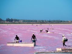 Lake Retba (Lac Rose), Senegal Just under an hour from Dakar, the capital city of Senegal, sits this naturally pink lake. Lake Retba, or Lac Rose, gets its distinctive color from a bacteria that produces a red pigment in order to absorb the sunlight.