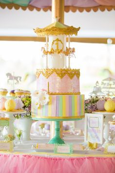 Tall and majestic birthday cake from a Gold & Pastel Carousel Birthday Party at Kara's Party Ideas.