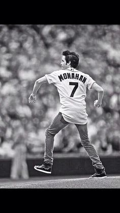 Pat Monahan from Train throwing the first pitch