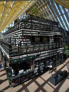 New library, Boekenberg Spijkenisse, is stack-built with a glass pyramid which houses the library---visible to every passerby. Inside the wide terraces are bookcases, creating a literal book mountain. The building provides plants for shade under the glass roof and a pleasant indoor climate without use of boilers or chillers.