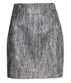 Short skirt in jacquard-weave fabric with a visible zip at back.