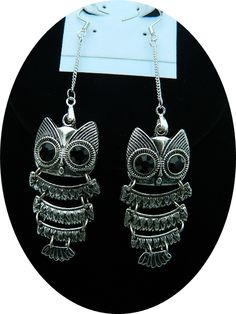 Owl earrings on tiny chain.