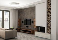 salon moderne avec déco murale aspect bois, meuble TV bas et colonnes en bois, écran plat mural et cheminée double face