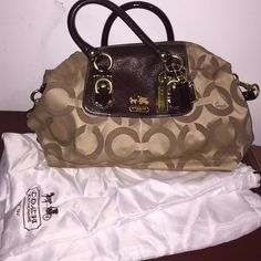 Coach Tan, Brown & Gold Purse This purse is in perfect condition! 100% authentic Coach. No ware & tear. Strong condition! Very pretty bag! Bag included. Coach Bags Shoulder Bags