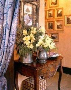 Charlotte Moss Aspen...beautiful fabric, warm woods, eclectic...