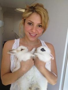 Shakira and her two adopted Dwarf Rabbits.