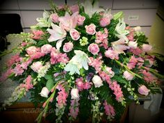 pink Sorbone Lilys of various pink shades, and pink roses with pink alstromeria, pink Larkspur & Pink Snap dragons.