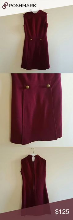 "🆕Vintage Single Pleat Dress🆕 Two brass buttons line the single flap pleat on the skirt of the dress. High neck with 1"" collar. Maroon in color. Knee length. NO discolorations. Like new condition!! No care/material tag sewn in. Hand made from union in 1950's. Long zipper in back. Soft lining -- not scratchy! Shaping darts sewn in around bust and waist. Heavy and thick -- would look great with knee high boots. Matching suit over coat also available for sale -- check my listings! Ask…"