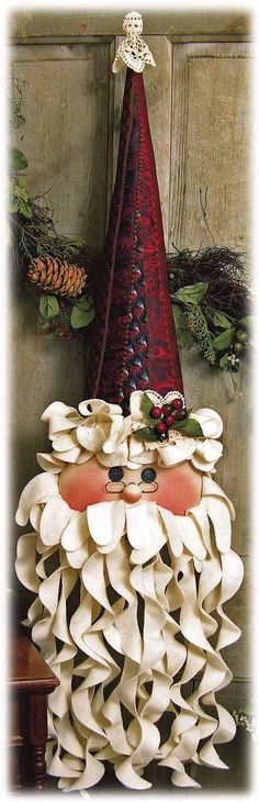 Yule love this unusual Santa with his hat made from neckties and curly beard…