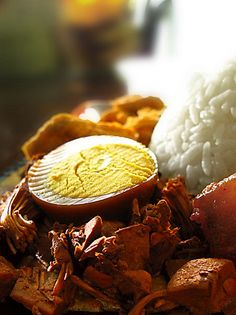 "It's called ""Gudeg"". It contains jackfruit, and also many spices. It sweet and delicious!"