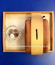 Montessori Practical Life activity - putting coins in a piggy bank. Using a wood bank cuts the noise down a bit for the classroom. The children do this activity over and over. Great fine motor activity! @wmswms (Westside Montessori School, Vancouver, BC)