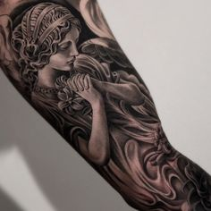 Amazing artist Jun Cha inner arm angel tattoo.